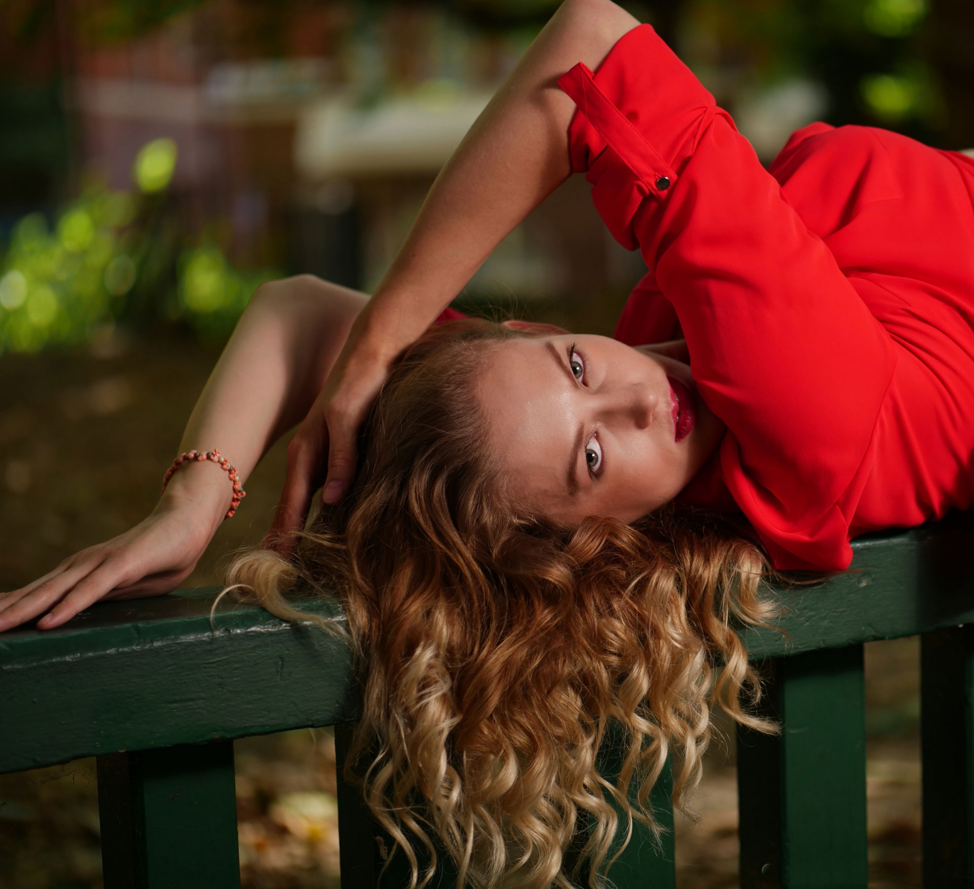 Girl-in-red-on-bench