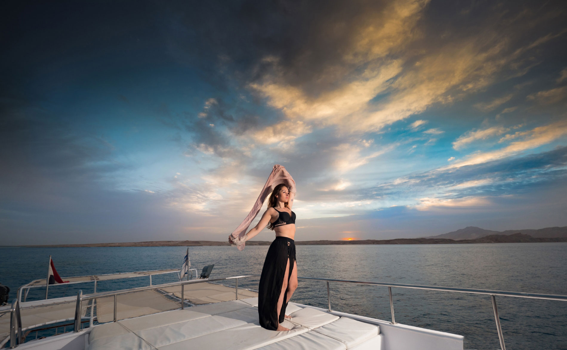 Girl-on-boat-at-sunset